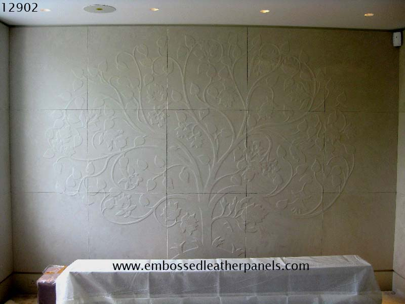 Embossed tree design panels covering the whole wall